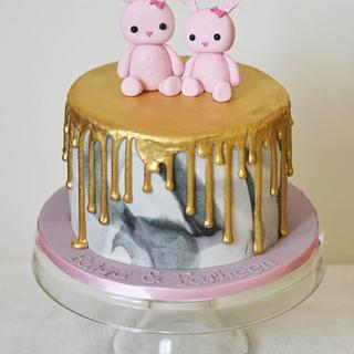 Bunnies on a gold drip marbled cake