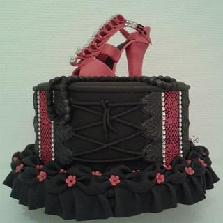 Corset style cake with high heeled shoe