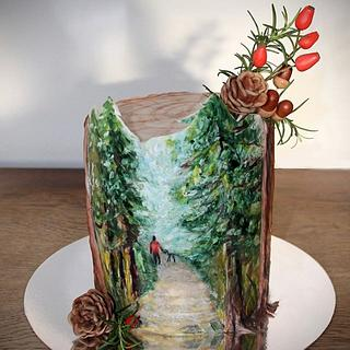 Hand painted cake for a man who loves to walk his dog in the forest.