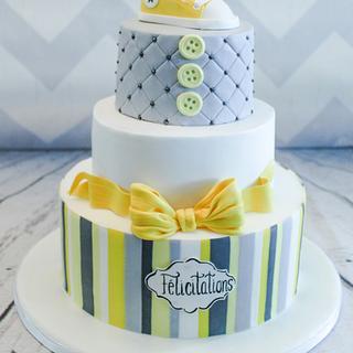 gray and yellow baby shower cake