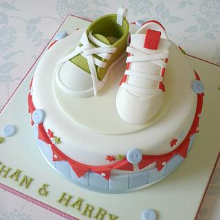 Baby shoe & football boot christening cake