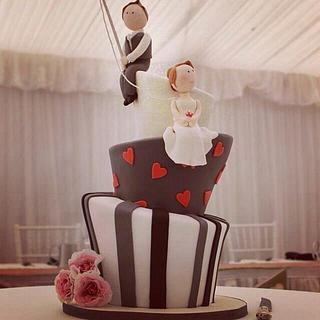 Mad Hatter wedding cake with fishing groom