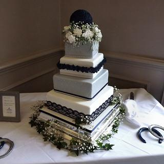 off set square, lace, cushion & ruffles wedding cake.. with flower ball! :)