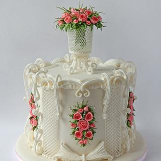 Cake with a bouquet of roses in an openwork vase