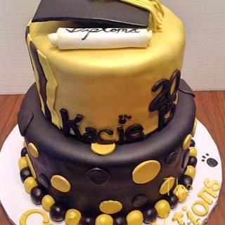 Gold and black graduation cake