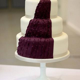 Asymmetrical purple ruffle wedding cake
