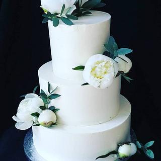 White wedding cake with peonies