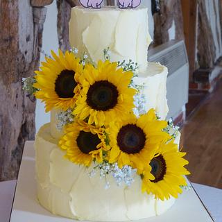 Rustic buttercream sunflower tractor mud wedding cake - Cake by Angel Cake Design