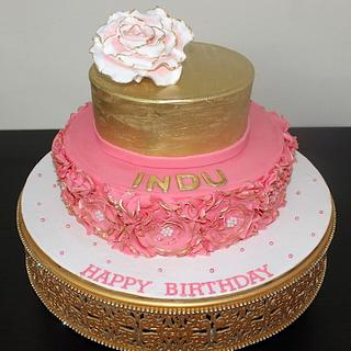Flower theme pink and gold cake for girls birthday