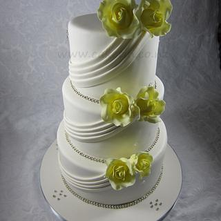Yellow Roses and Fabric Drapes Wedding cake