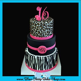 Pink and black animal print cake