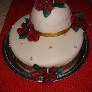 My first fondant cake and hand made Roses