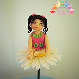 Little girl on a daisy