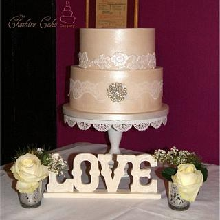Lace and brooch wedding cake