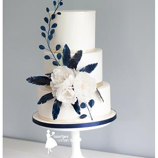Blue waterpaper feathers and white peonies