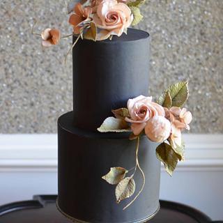 Blush sugar roses on black cake