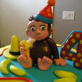 CURIOUS GEORGE THEMED CAKE AND CUPCAKES