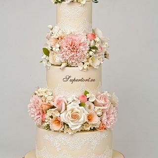 Floral wedding cake with peonies, roses, hydrangea and freesias