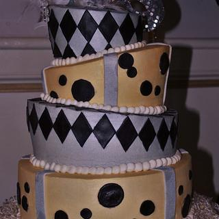 Topsy Turvy gold,silver, black birthday cake