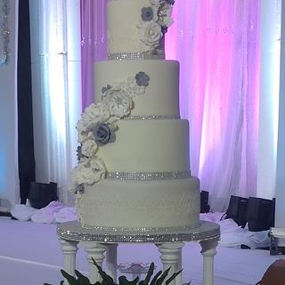 White, Silver, and Gray Wedding Cake with Handmade Flowers