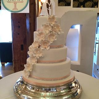 4 tier white wedding cake with peach accents - Cake by Mimi's Sweet Treats