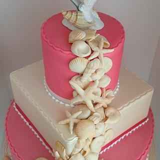 Watermelon/Ivory seashell wedding cake