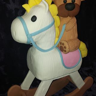 Teddy riding Rocking Horse