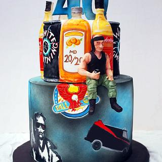 80's inspired booze and action heros. - Cake by Danielle Lainton