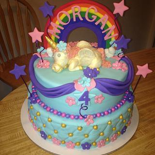 Rainbow unicorn tiered cake