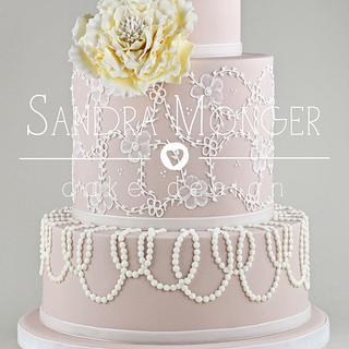 Nude lace and bead piped wedding cake