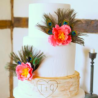 Peacock feather, stylised wild rose and birch log wedding cake