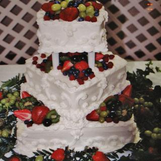 Square wedding cake with fresh fruit