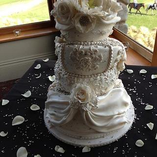 White floral Topsy Turvy Wedding Cake