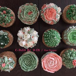 Succulents spring theme cupcakes .