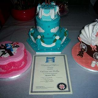 PME course cakes and diploma