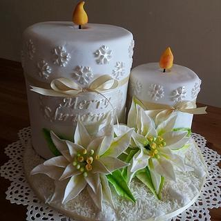 Christmas candle cake with white poinsettia