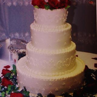 Round red rose buttercream wedding cake