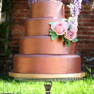 Rose gold 4 tier cake with sugar roses