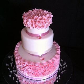 Pink ruffle and hydrangea wedding cake