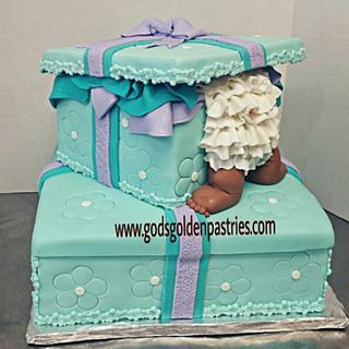 Baby in gift box baby shower cake