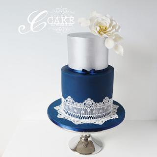Navy and silver lace wedding cake.
