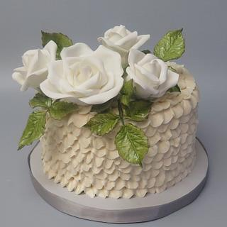 White roses and buttercream ruffles cake