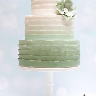 Mint green ombré ruffle wedding cake