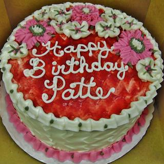 Raspberry buttercream filled cake w/ BC flowers