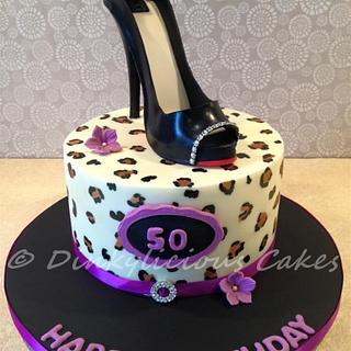 Black stiletto cake