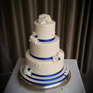 Royal blue and ivory wedding cake