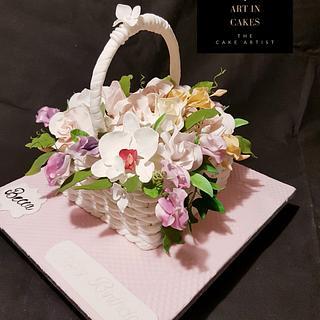 Wicker basket full of garden flowers