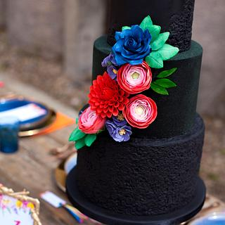 Black beauty textured cake with bright flowers