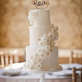 White wedding Cake with wafer paper rolled roses