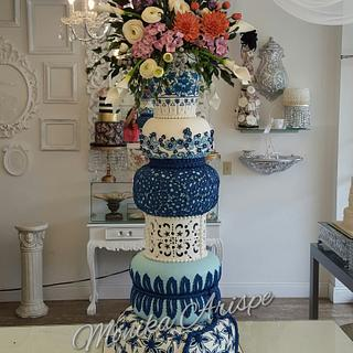 Wedding Cake with vase flowers topper